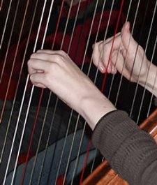 hands and harp strings